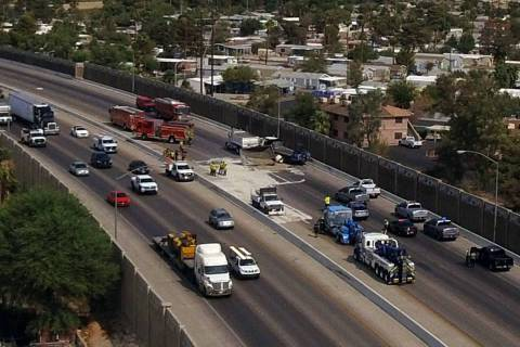 Firefighters extracted an injured driver from the cab of his semi truck after a collision with ...
