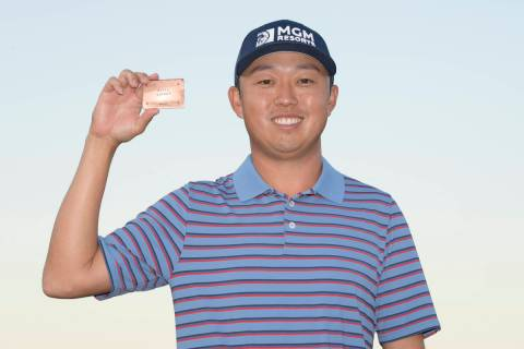 David Lipsky shows off his PGA Tour card after earning his promotion from the Korn Ferry Tour d ...