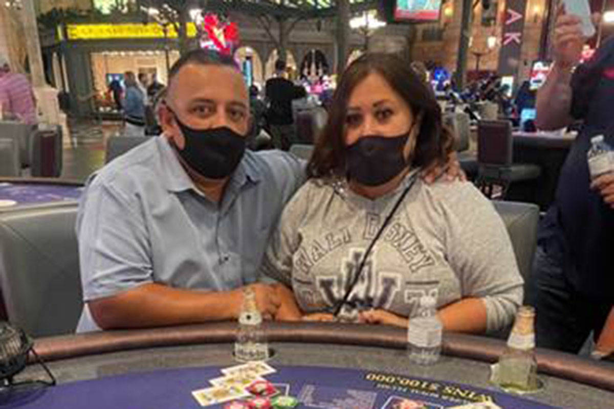 Alex Martinez and his wife pose after winning a jackpot of $109,603 at Paris Las Vegas on Frida ...
