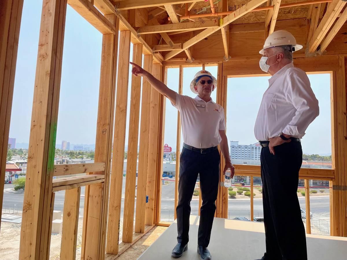 Robert Feibleman, executive vice president of construction for Nevada HAND, left, shows Nevada ...