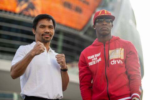 Manny Pacquiao, left, and Yordenis Ugas, pose during their grand arrival event at Toshiba Plaza ...