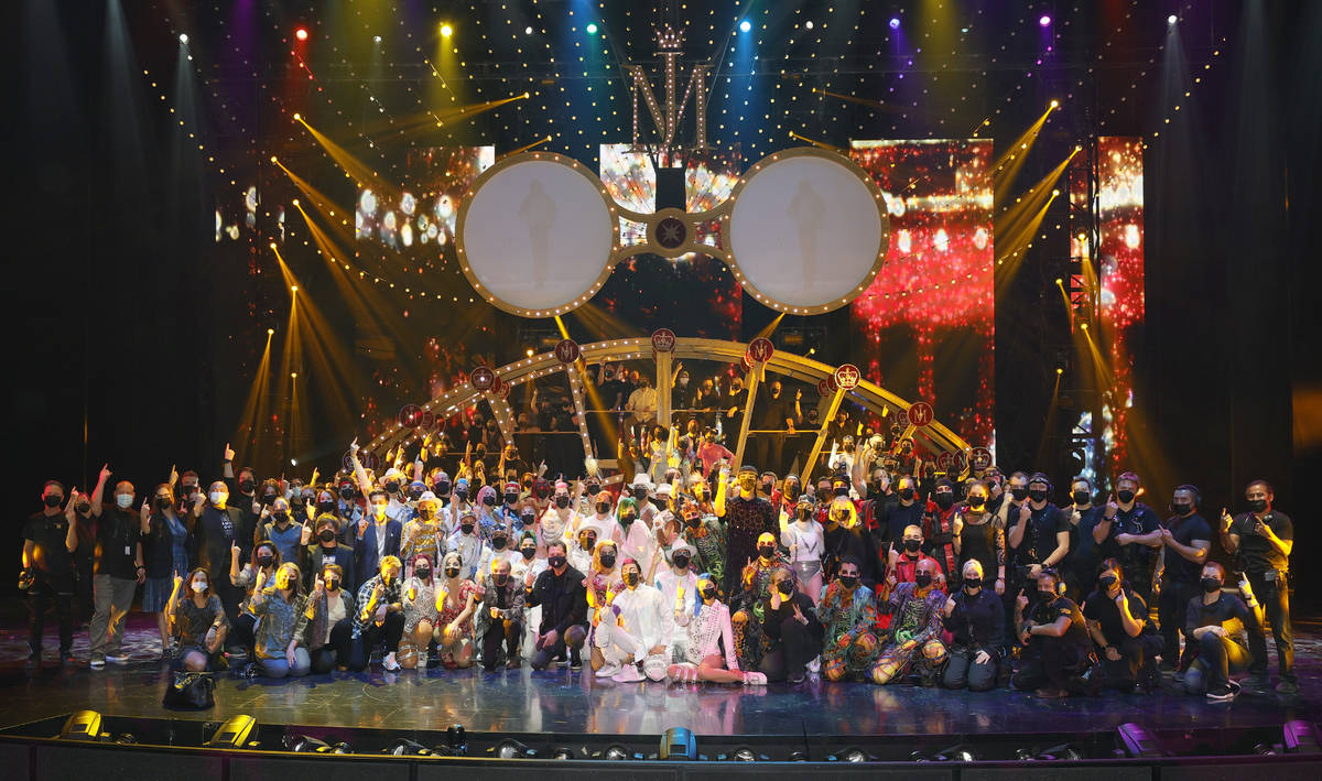 """LAS VEGAS, NEVADA - AUGUST 19: Cast and crew pose after the grand reopening of """"Michael J ..."""