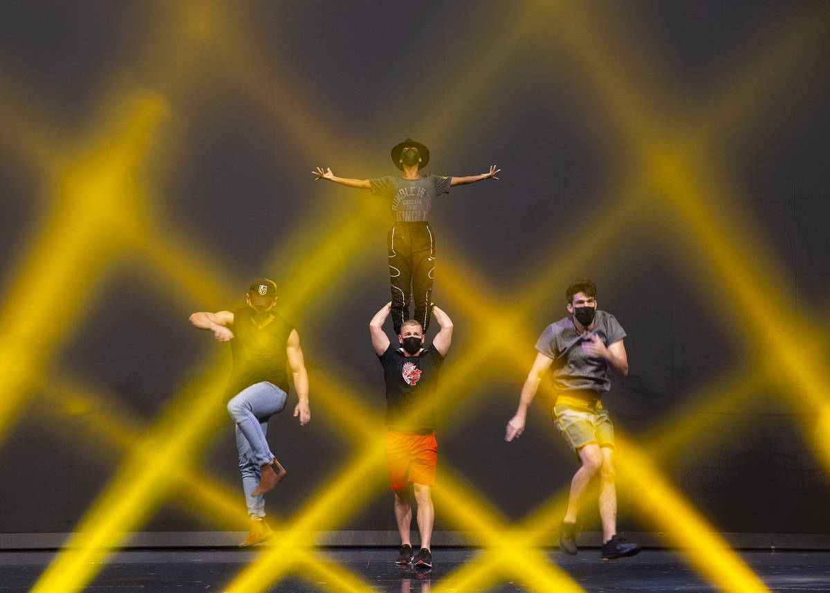 Performers rehearse for Michael Jackson One by Cirque du Soleil in the show's theater at Mandal ...