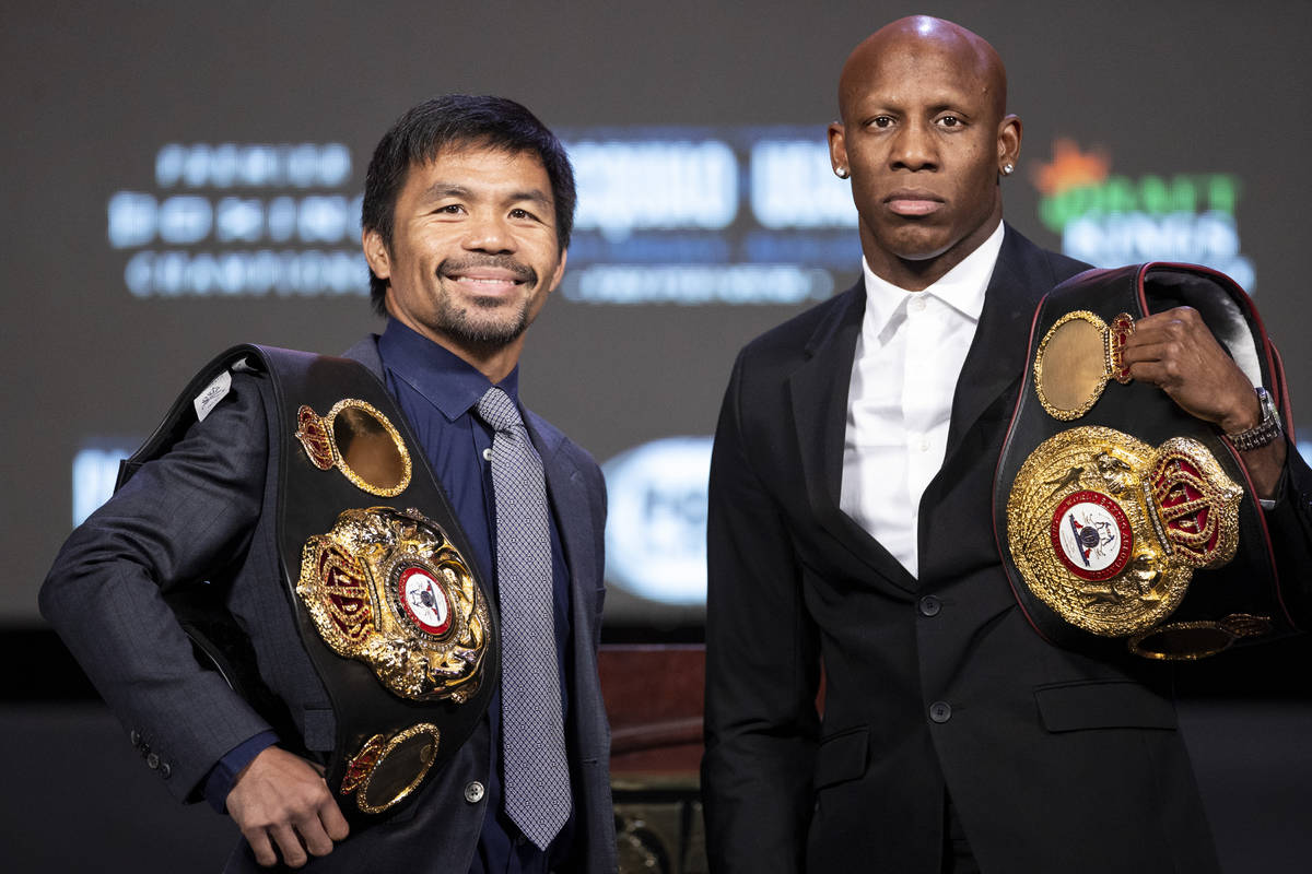 Manny Pacquiao, left, and Yordenis Ugas, pose during a press conference at the MGM Grand Garden ...