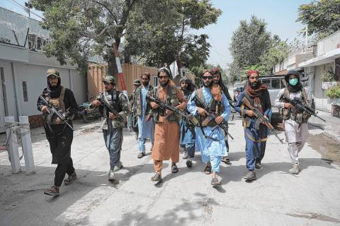 Taliban fighters patrol in the Wazir Akbar Khan neighborhood in the city of Kabul, Afghanistan, ...