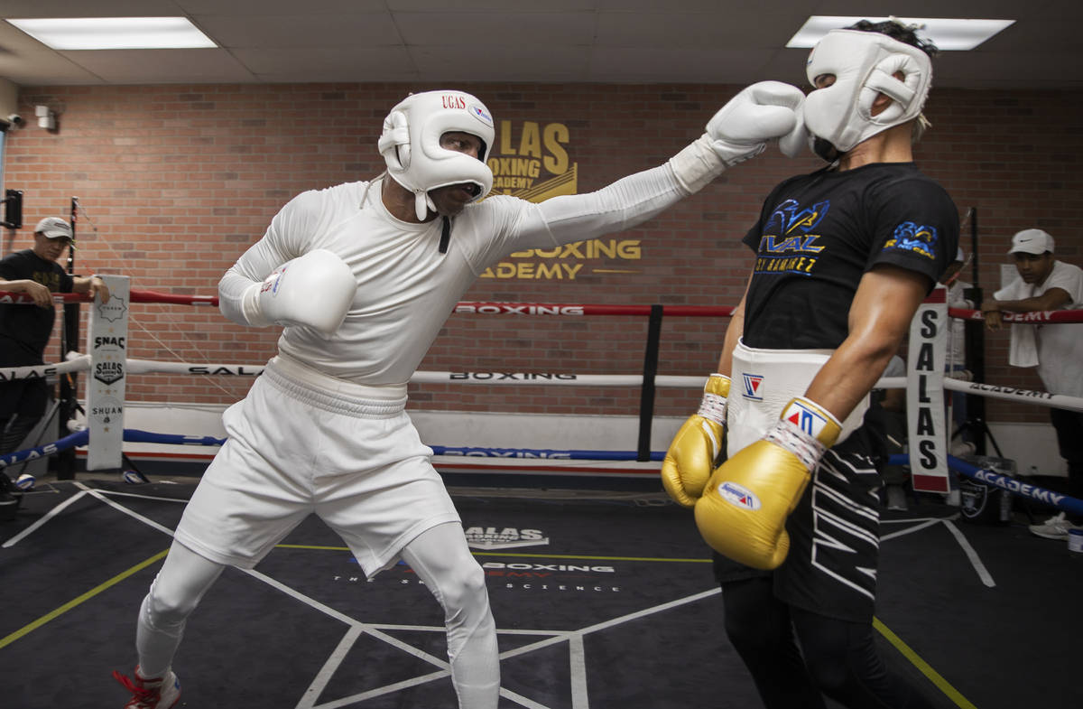 Welterweight Yordenis Ugas, left, trains for his upcoming fight with Manny Pacquiao on Monday, ...