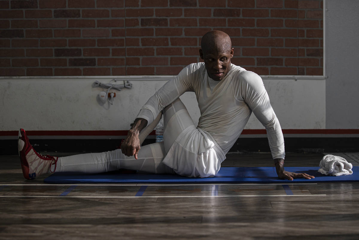Welterweight Yordenis Ugas stretches after a training session for his upcoming fight with Manny ...
