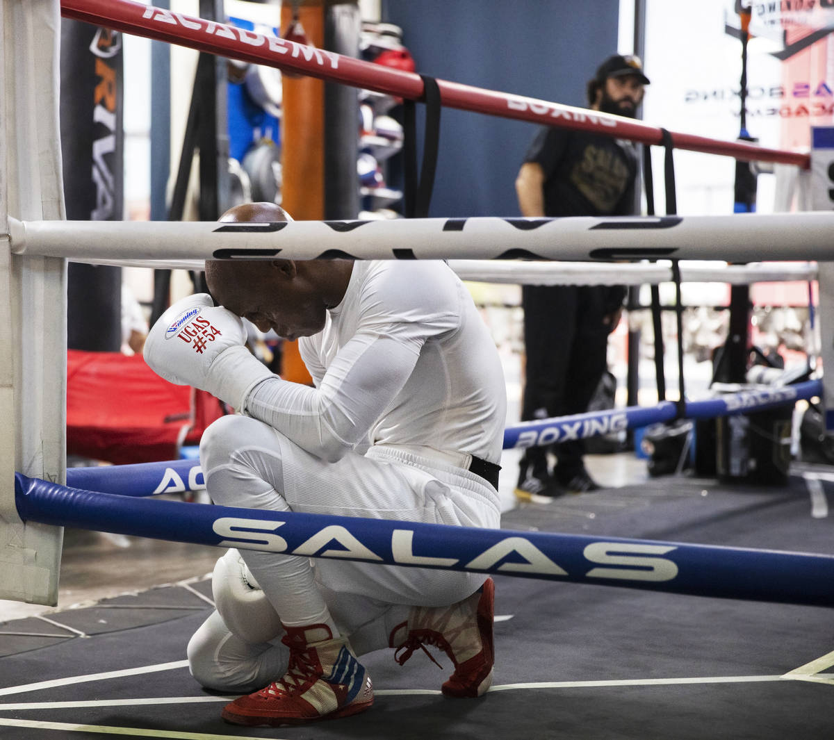 Welterweight Yordenis Ugas prays before the start of a training session for his upcoming fight ...