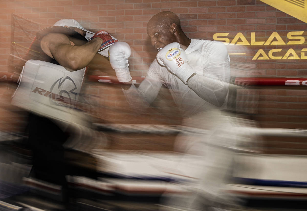 Welterweight Yordenis Ugas, right, trains for his upcoming fight with Manny Pacquiao on Monday, ...