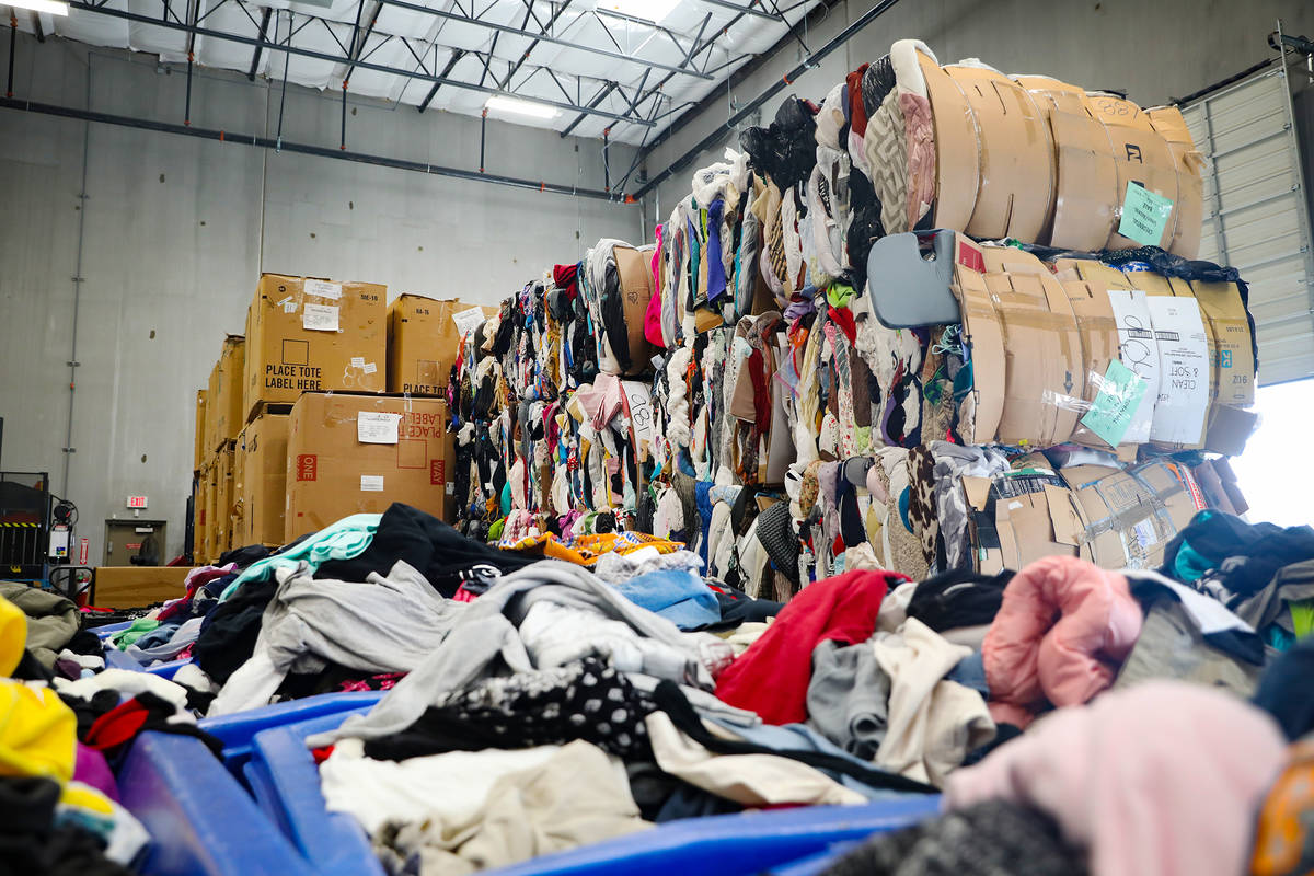 Bales of clothes at the warehouse at the Goodwill Clearance Center in Las Vegas, Monday, Aug. 1 ...