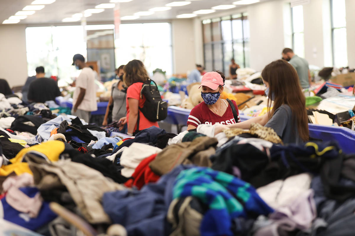 Shoppers dig through items in the thrift store portion of the Goodwill Clearance Center in Las ...