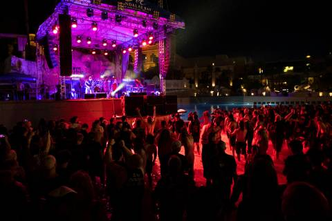 People mosh in the water at the beach stage as Pig Destroyer performs during Psycho Las Vegas a ...