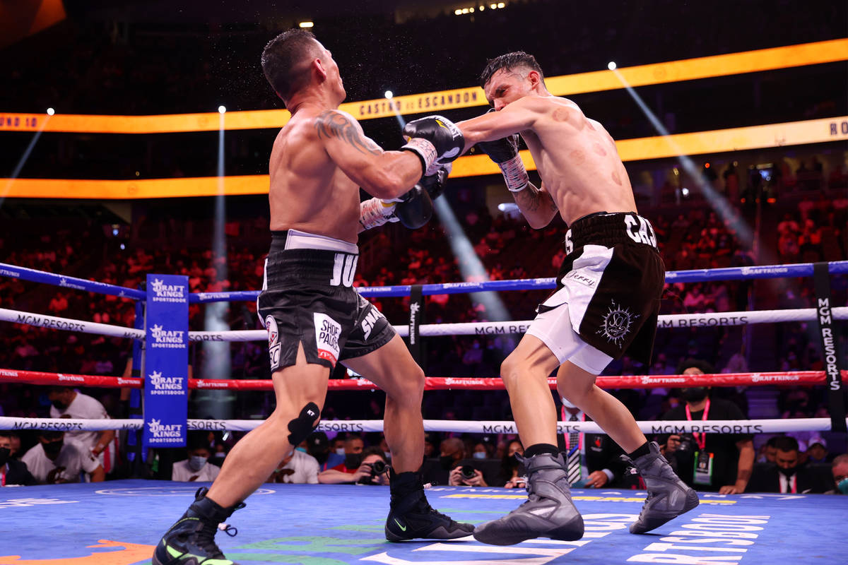 Carlos Castro, left, connects a punch against Oscar Escandon, in the 10th round of the featherw ...