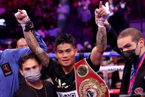 Mark Magsayo raises his arms in victory after his 10th round knockout win against Julio Ceja in ...