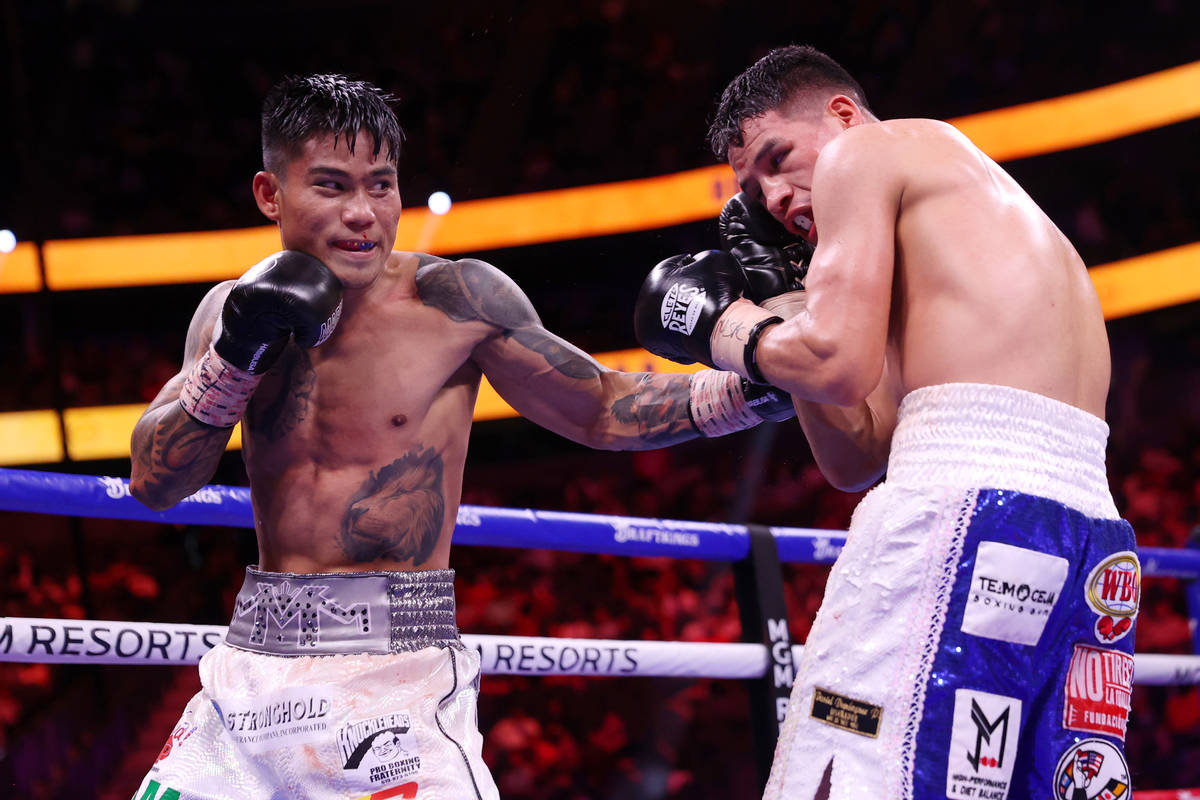 Mark Magsayo connects a punch against Julio Ceja in the ninth round of the featherweight bout a ...