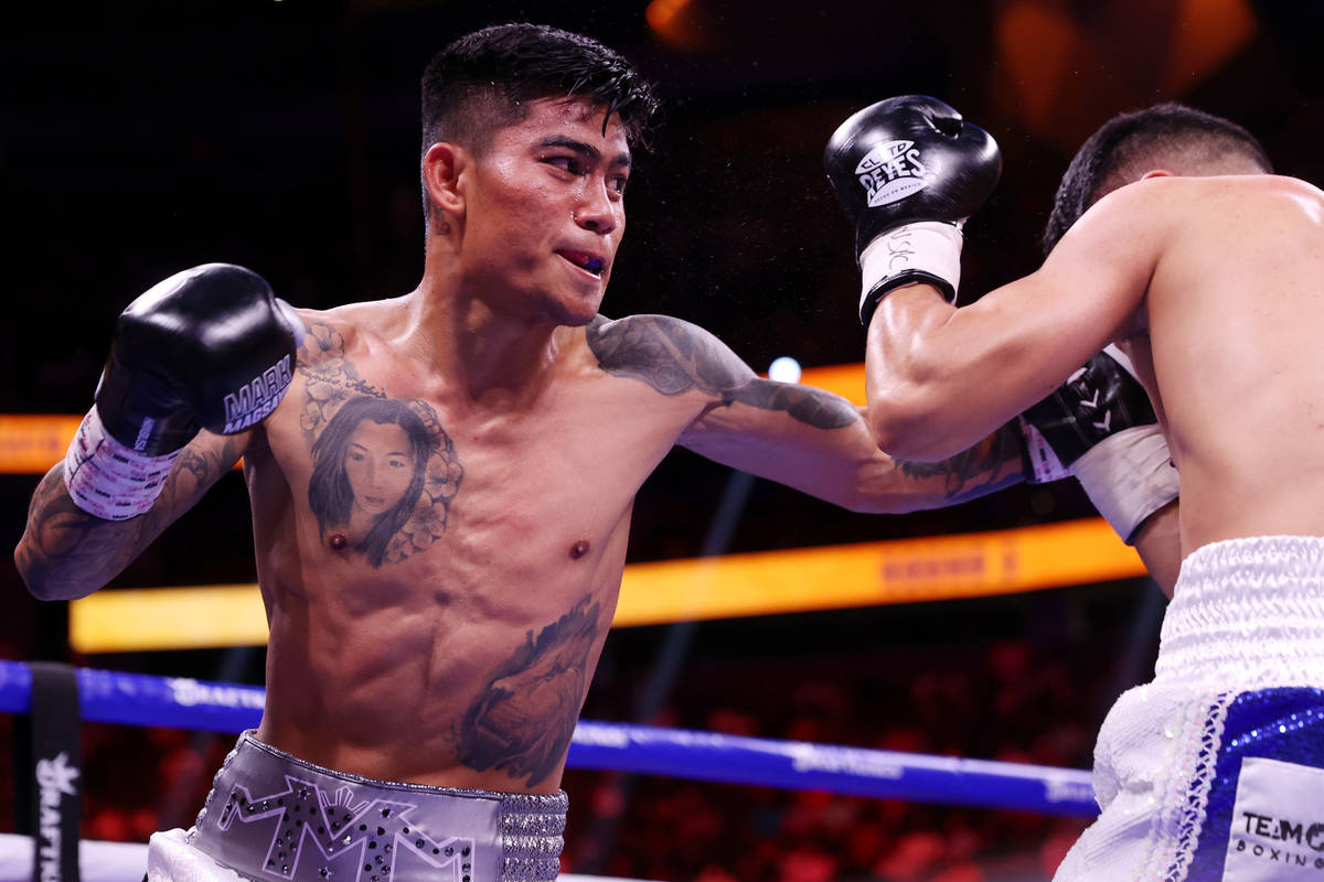Mark Magsayo connects a punch against Julio Ceja in the third round of the featherweight bout a ...