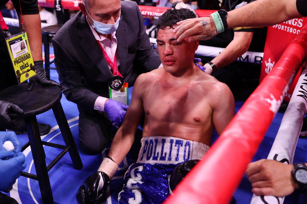 Julio Ceja receives assistance after getting knocked out by Mark Magsayo in round 10th of the f ...