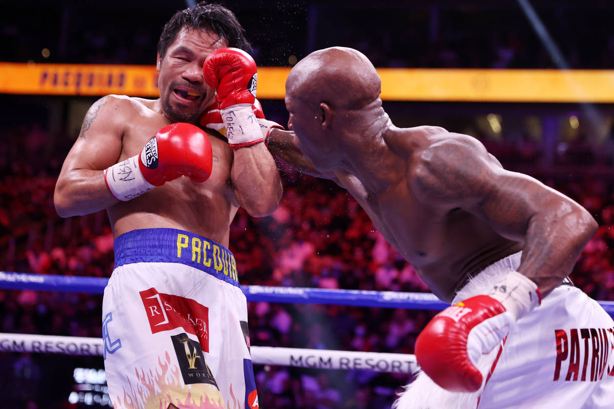 Yordenis Ugas, right, connects a punch against Manny Pacquiao in the sixth round of the WBA Wor ...