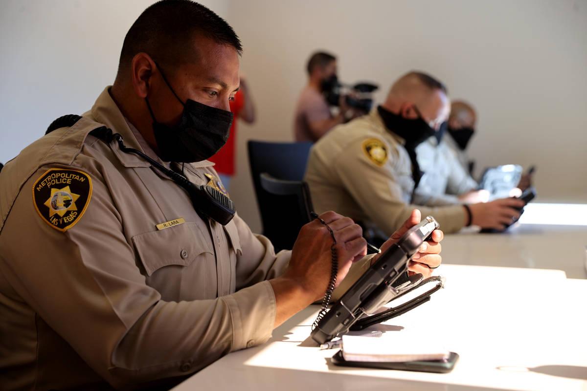 Las Vegas police officers, including Ricky Lara, left, work in the Las Vegas police community i ...