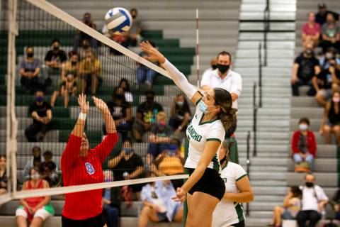 Rancho's Summer Martin (5) kills the ball while Western's Mia Perez (8) jumps to block during t ...