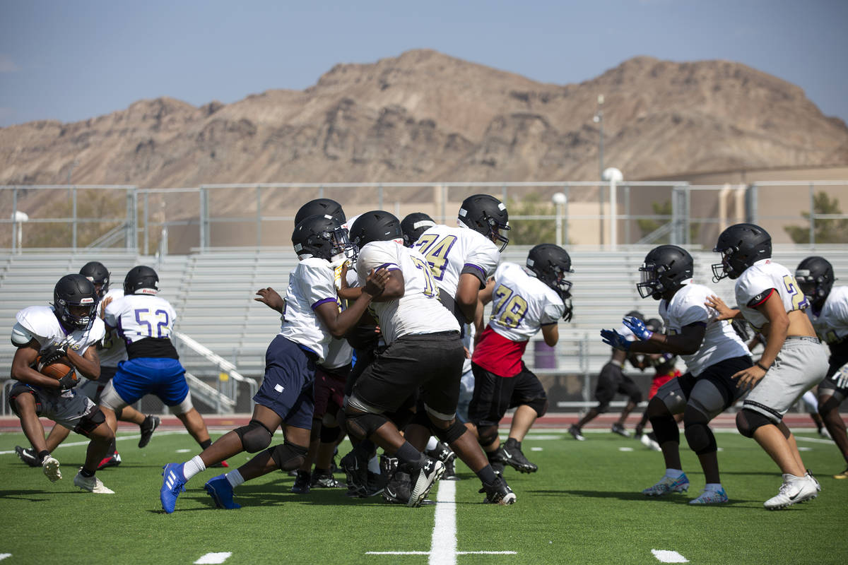 The Sunrise Mountain High School varsity football team practices at their school's field on Wed ...
