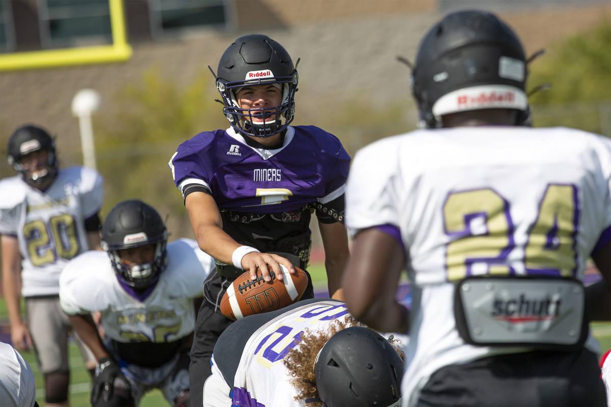 Quarterback Tyler Shea, center, runs drills during varsity football team practice at Sunrise Mo ...