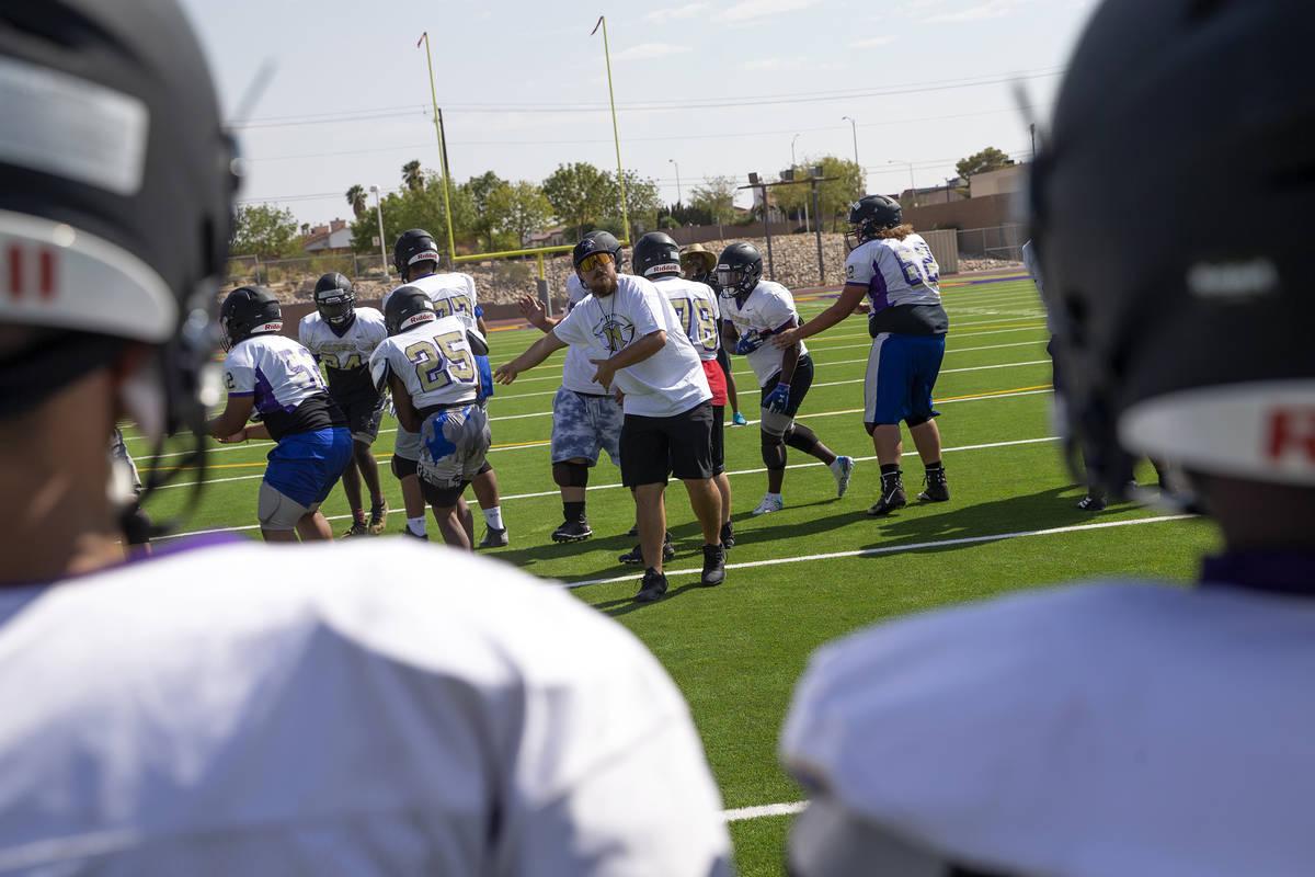 Head coach Joshua Bennett, center, leads varsity football team practice at Sunrise Mountain Hig ...