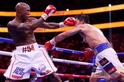 Yordenis Ugas, left, battles Manny Pacquiao in the ninth round of the WBA World Welterweight Ti ...
