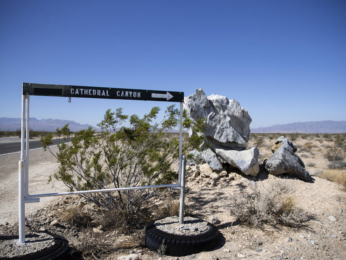 The sign pointing to Cathedral Canyon is shown near a cliff, on Wednesday, Aug. 18, 2021 where ...