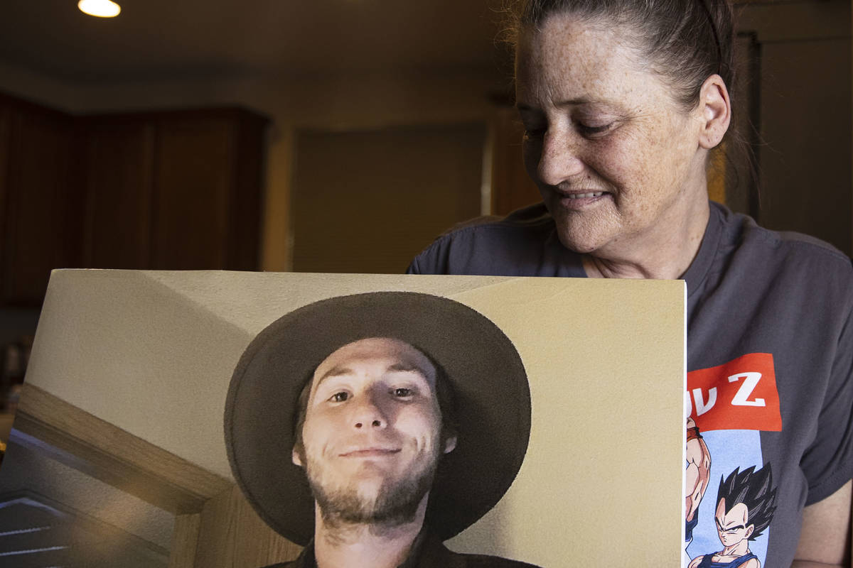 Kassy Robinson holds her son Roy Jaggers' photograph at her Las Vegas home on Saturday, Aug. 21 ...