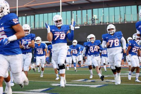 Bishop Gorman players including Jake Taylor (79) take the field for their football game against ...