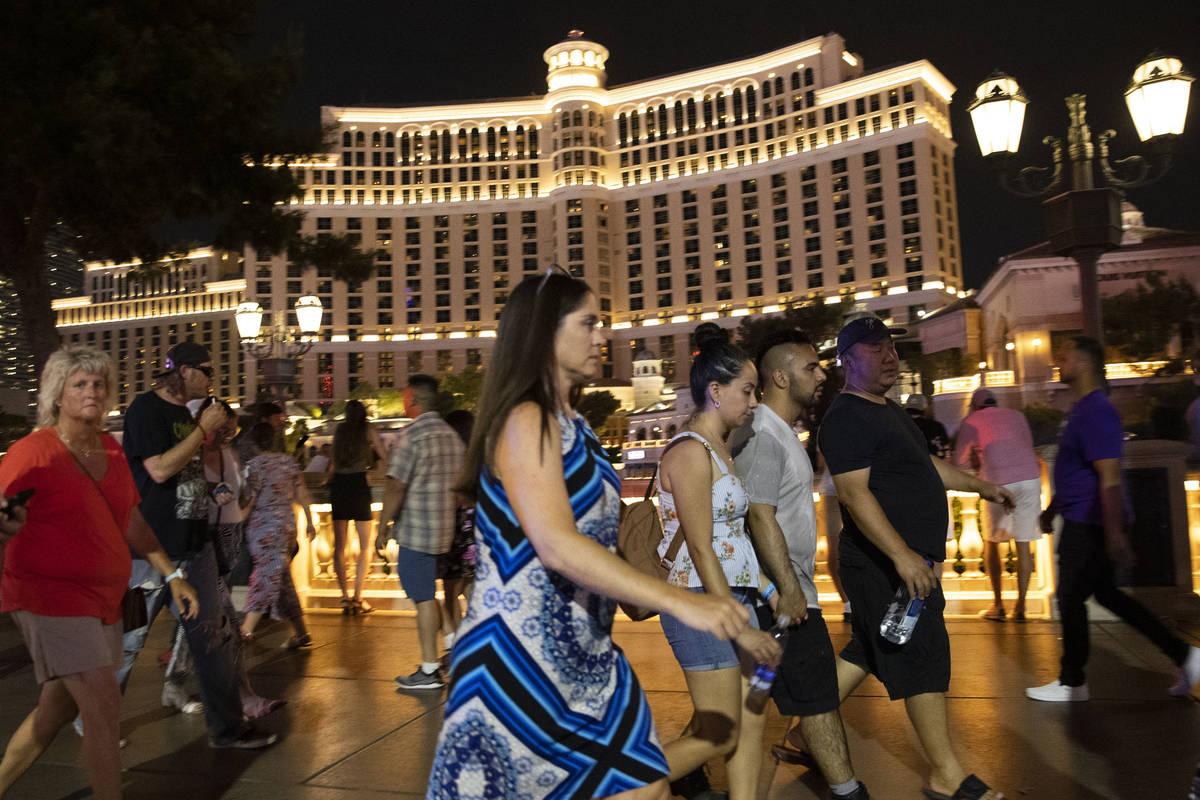 People walk past the Bellagio hotel-casino, on Saturday, July 10, 2021, in Las Vegas. (Bizuayeh ...