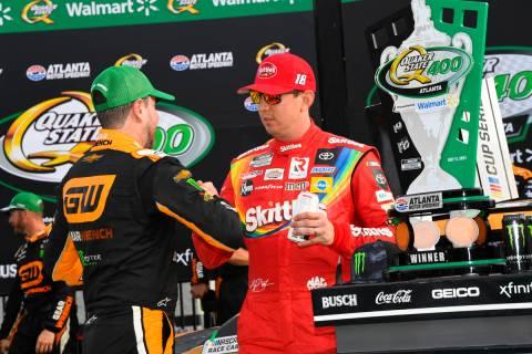 Kurt Busch is congratulated by his brother Kyle Busch after winning a NASCAR Cup Series auto ra ...