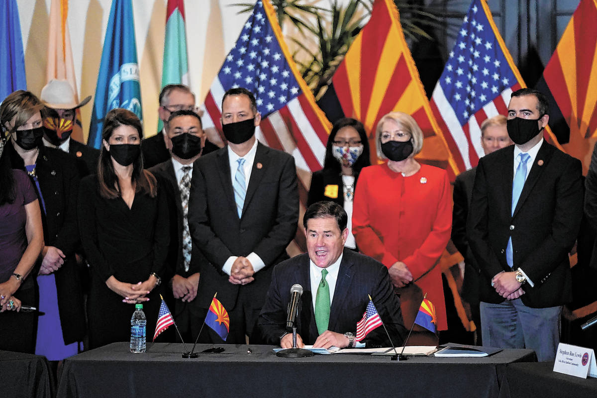 Republican Arizona Gov. Doug Ducey speaks at a bill signing allowing a major expansion of sport ...