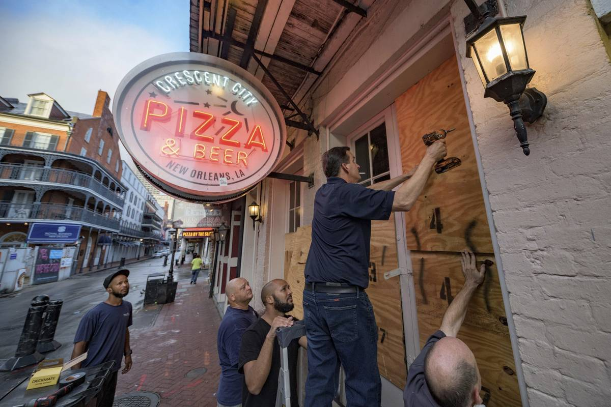 Michael Richard of Creole Cuisine Restaurant Concepts boards up Crescent City Pizza on Bourbon ...