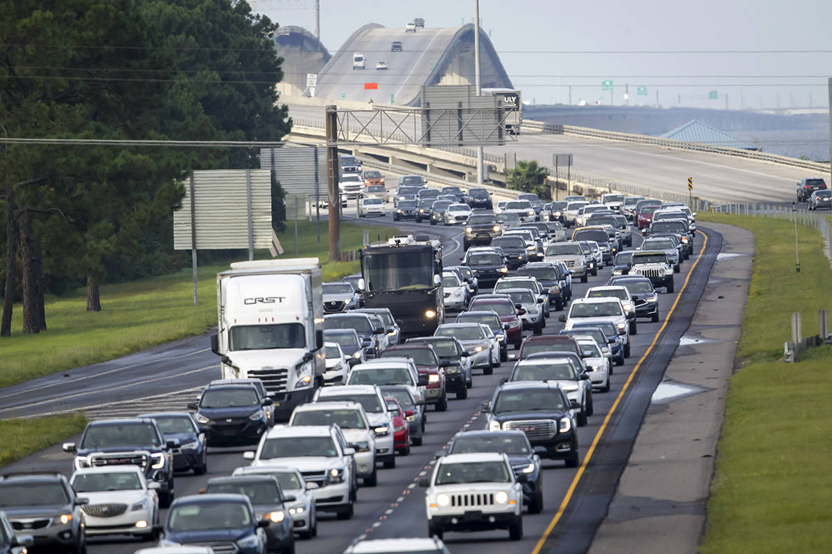 Interstate 10 near Slidell, La., is packed with evacuees heading east Saturday, Aug. 28, 2021, ...