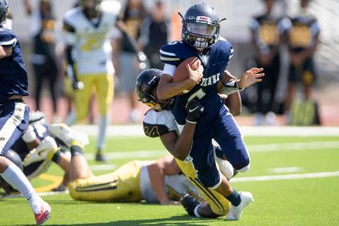 Cheyenne quarterback Kaleigha Plett (6) is tackled by Clark High School's defensive end Jhamari ...