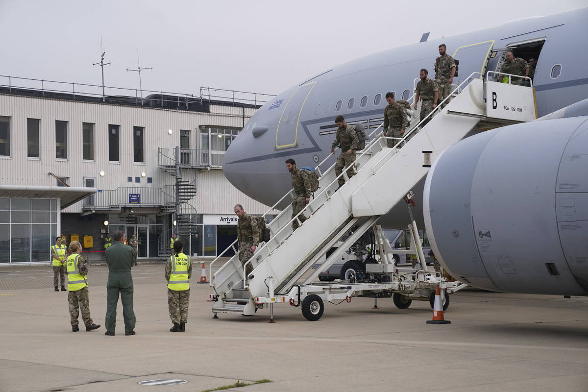 Members of the British armed forces 16 Air Assault Brigade disembark a flight from Afghanistan ...