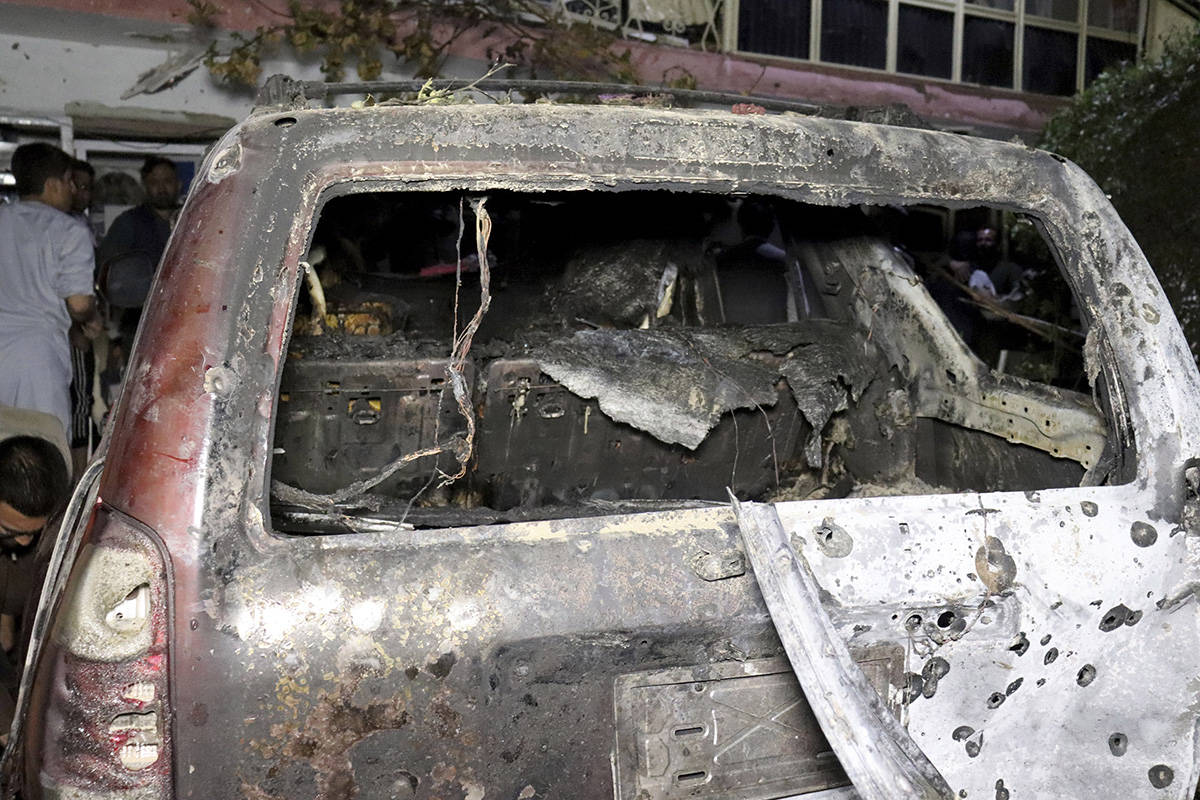 A destroyed vehicle is seen inside a house after a U.S. drone strike in Kabul, Afghanistan, Sun ...