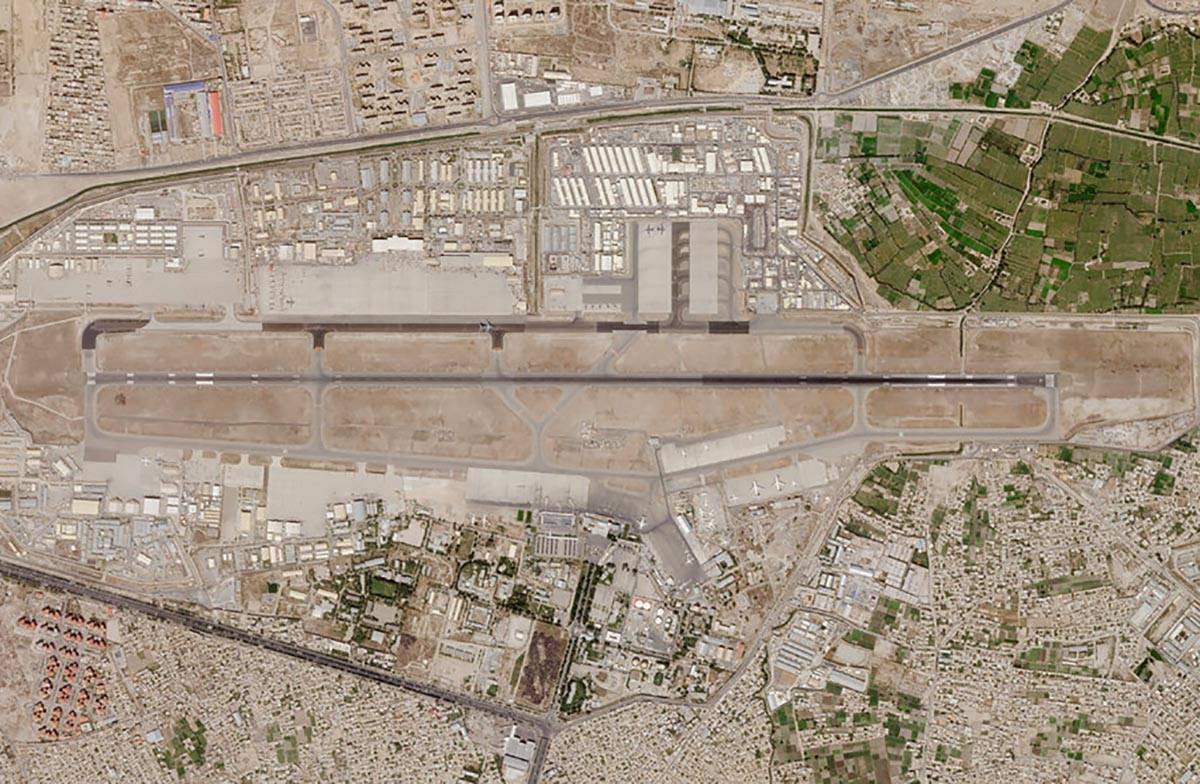 In this satellite photo taken by Planet Labs Inc., Kabul's international airport is seen Saturd ...
