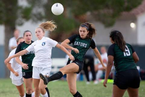 Green Valley's Chase Northam (14) attempts to pass while Foothill's Emma Rietz (9) falls behind ...