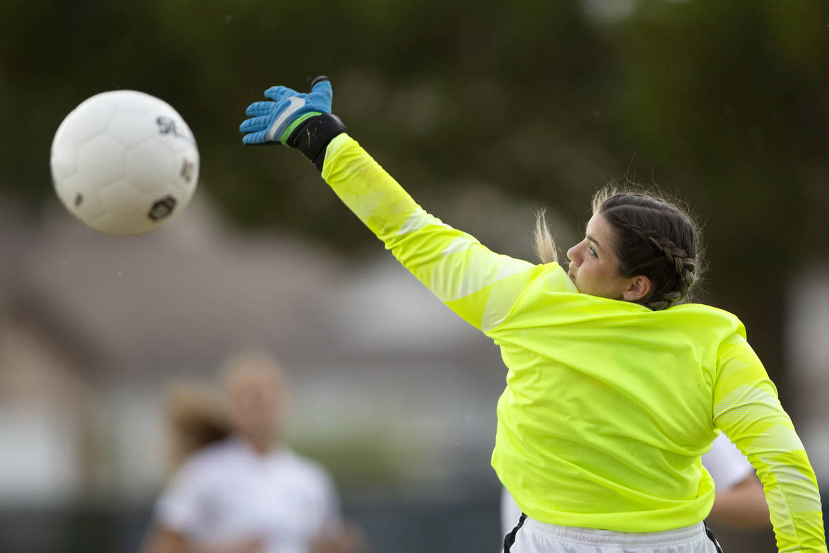 Foothill's goaltender Lexie Qualls (19) saves a goal shot by Green Valley during their high sch ...