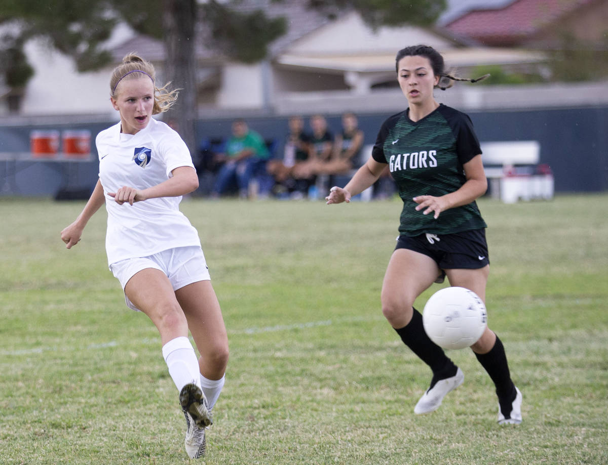 Foothill's Emma Rietz (9) scores a goal on Green Valley next to Green Valley's Brenna Knight (1 ...