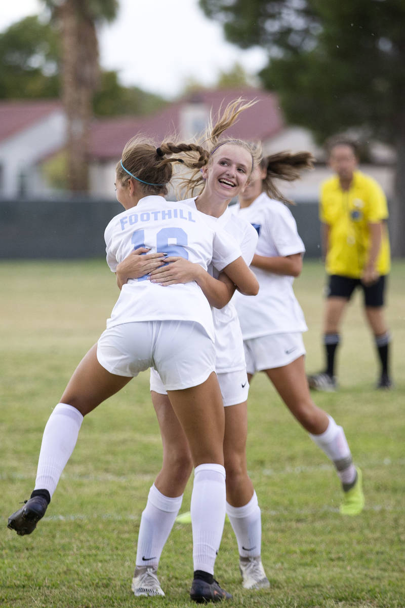 Foothill's Isabelle Simoneau (16) jumps to hug her teammate Emma Rietz (9), who scored a goal o ...
