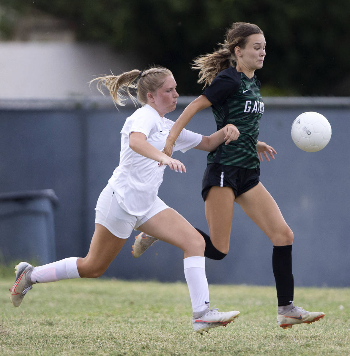 Foothill's Morgan Huff (18) catches up with Green Valley's Riley Cardenas (1) during their high ...