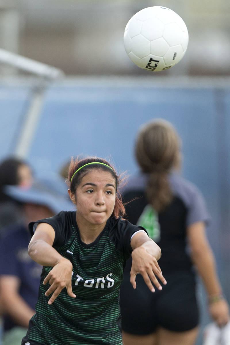 Green Valley's Angelique Ruiz-Salazar (8) throws in during her high school soccer game against ...