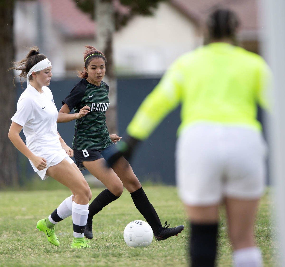 Foothill's Aly Papka (11) catches up with Green Valley's Angelique Ruiz-Salazar (8) while she e ...