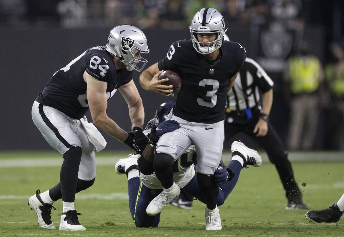 Raiders quarterback Nathan Peterman (3) scrambles in the second quarter during an NFL preseason ...
