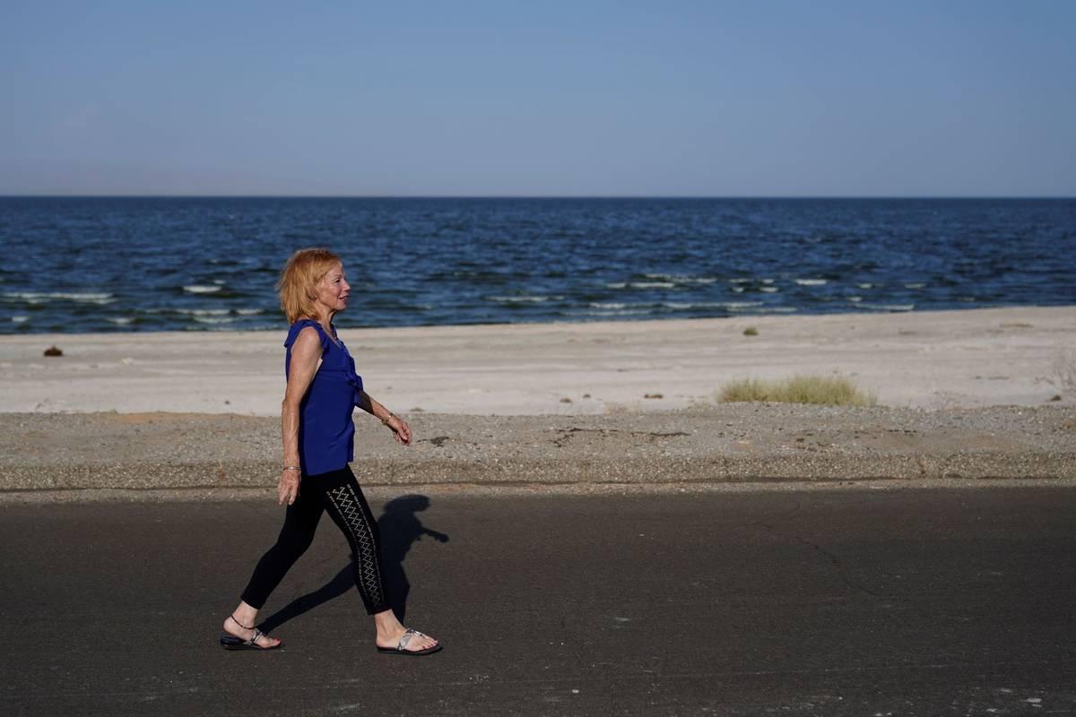 Carlene Ness walks on a road along the Salton Sea in Desert Shores, Calif., Wednesday, July 14, ...