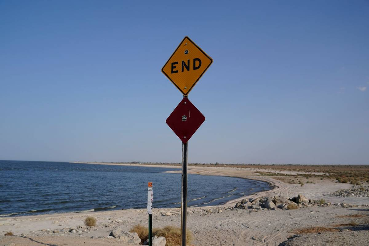 A sign is posted at the end of a road leading to the Salton Sea in Desert Shores, Calif., Wedne ...